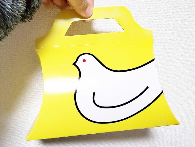 黄色に白い鳩のパッケージデザイン